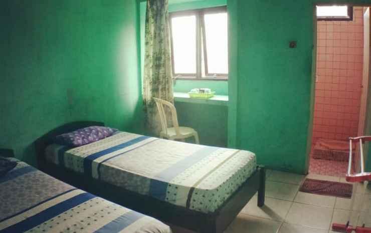Penginapan Purnama Syariah Palembang - Twin Room Fan