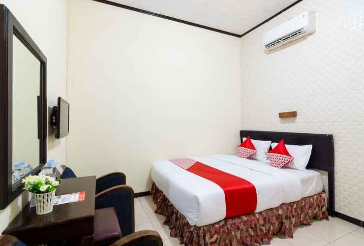 Kamar penginapan di OYO 1338 Hotel Sartika