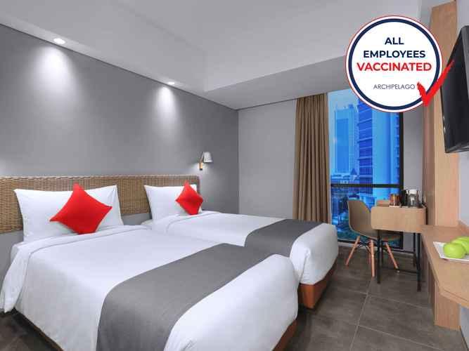 BEDROOM Neo Hotel Puri Indah by ASTON