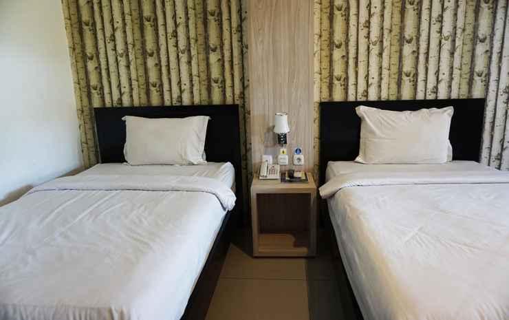 Saygon Inn & Cottage Pasuruan - Deluxe Room