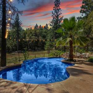 1.25 acre parcel with a beautiful house, 4 car garage, and a POOL!