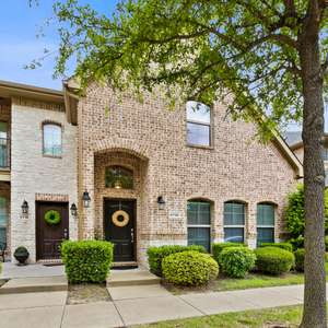 UPDATED ALL BRICK TOWNHOME WITH FENCED YARD IN COVETED BELLA CASA NEIGHBORHOOD OF FRISCO