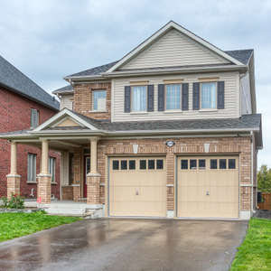 """Stunning """"Tribute Built"""" Executive Home Located on a Ravine Lot In Highly Sought After Windfield Farms Community"""