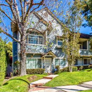 Welcome to this stunning Cape Cod Hamptons style Sherman Oaks end-unit townhome
