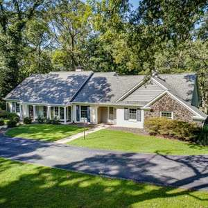 Paradise on Wooded Acreage with a Private Lake