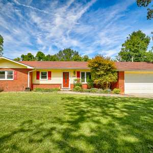 Update Ranch with a Wooded View and Easy Commute to Downtown
