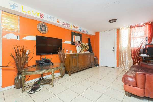 Nice size family room inside this House for sale In Jamaica Queens NY