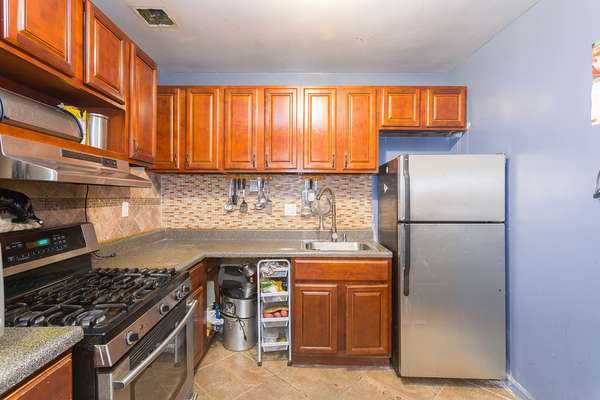 Lots of counter space in this Kitchen in this House for sale In Jamaica Queens NY