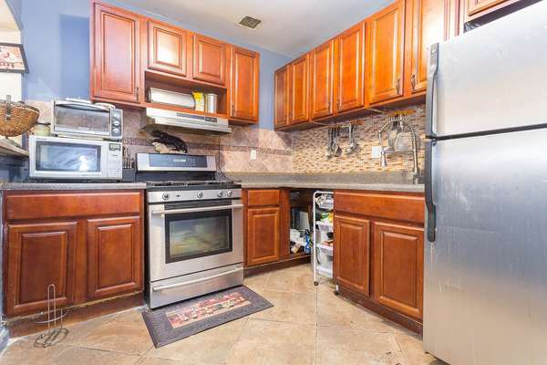 Nise size appliances inside this House for sale In Jamaica Queens NY