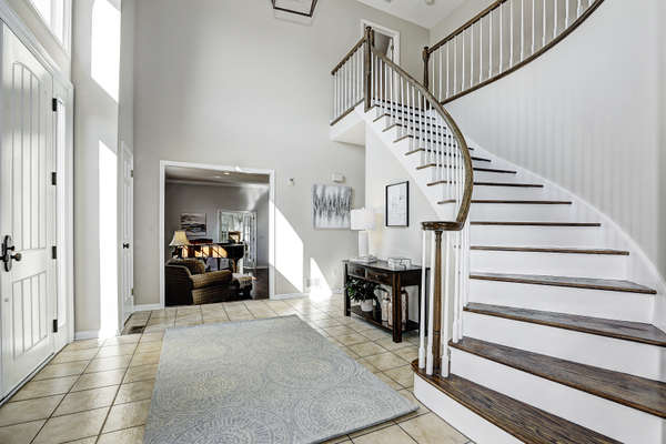 INVITING ENTRY WITH CURVED STAIRCASE