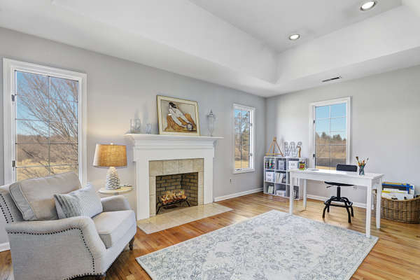 SITTING ROOM WITH TRAY CEILING & FIREPLACE