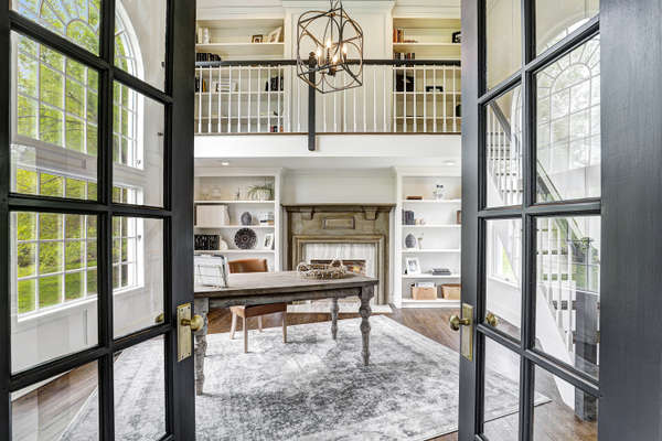FRENCH DOORS OPEN TO LIBRARY FROM LIVING RM