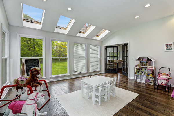 CONSERVATORY OPENS TO GREAT ROOM