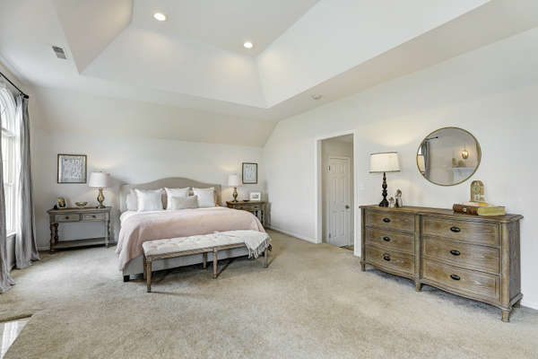 MASTER SUITE LEADS TO WALK-IN CLOSETS AND RENOVATED BATHROOM