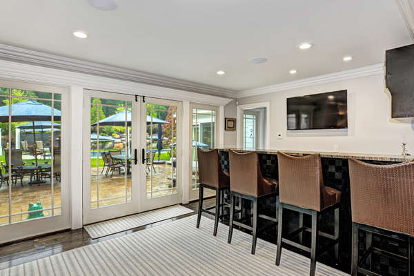 WET BAR LOCATED JUST OFF THE PATIO FOR EASY ENTERTAINING