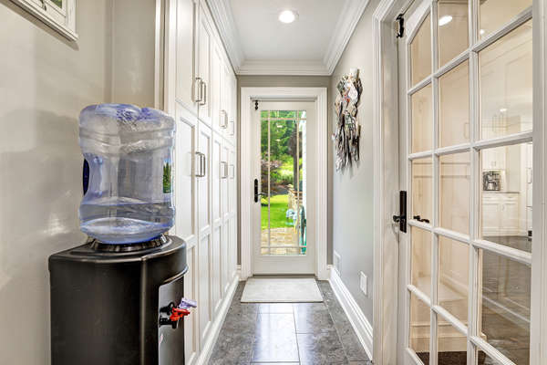 MUD ROOM WITH DOOR TO BACKYARD AND PANTY CLOSETS