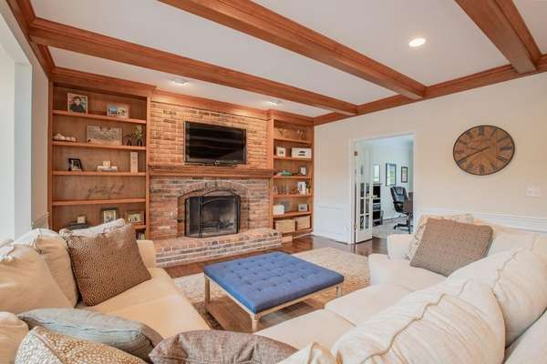 Brick Surround Natural Fireplace with a Wood Mantle