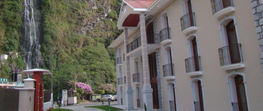 The facade of Sangay Spa facing rugged mountains