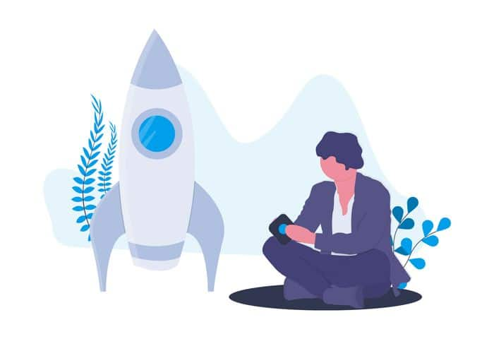 Digital Projects - man sitting down next to a rocket