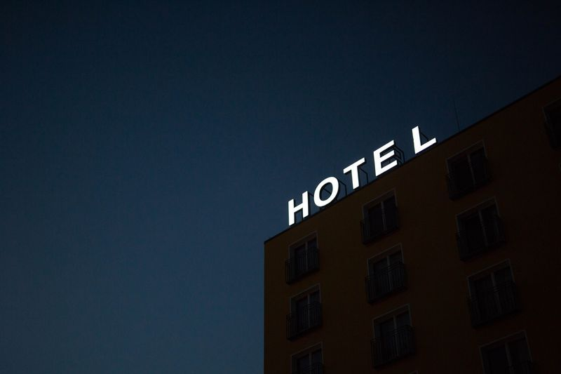 Coronavirus and Reopening - hotel sign at night