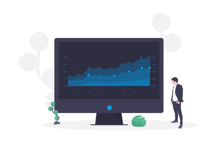 online marketing agency - man standing next to a giant black screen showing data in blue