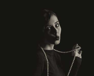 instagram alt text woman in the dark with pearls