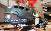This display at The Studebaker National Museum in South Bend, Indiana, depicts a sedan body being dropped on a frame.