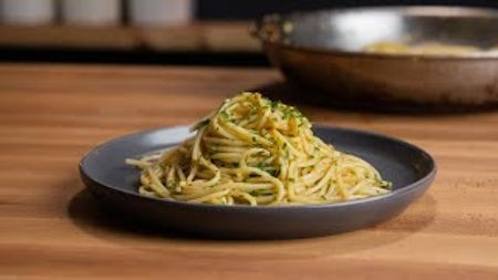 Here are the ingredients you'll need:- 8 oz Dry Spaghetti (or other pasta), bronze cut- 1/4 Cup High-Quality Extra-Virgin Olive Oil- 8 Medium Cloves Garlic- 1-2 tsp Red Pepper Flakes- 1/4 Cup Parsley, finely chopped- 2 qt Water- 25g (~3 Tbsp) Kosher Salt- Lemon juice and/or Parmesan Cheese (optional, to taste)CC BY Youtube: The Regular Chef