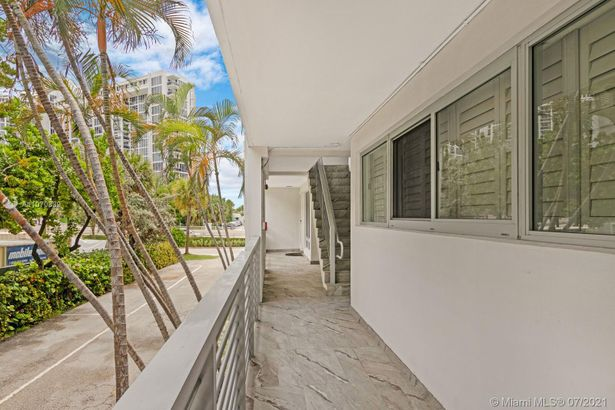 10240 Collins Ave #106