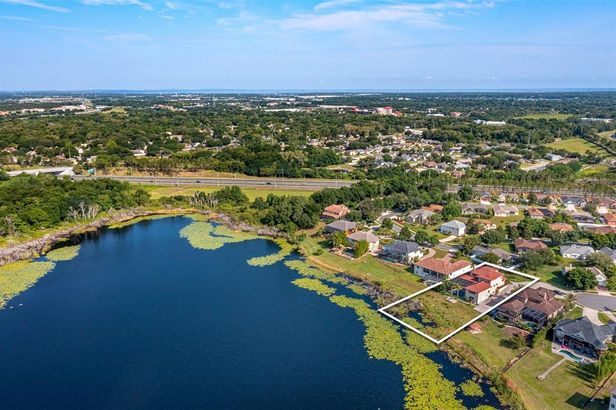 9125 LAKE COVENTRY COURT