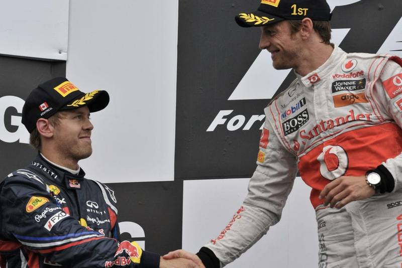 Jenson Button and Sebastian Vettel shake hands on the podium after the 2011 F1 canadian grand prix