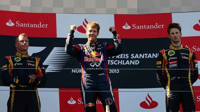 Race winner Sebastian Vettel with Kimi Raikkonen and Romain Grosjean on the podium after the 2013 German Grand Prix at the Nürburgring