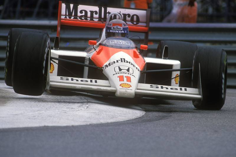 Alain Prost rides the kerbs in his McLaren Honda at the 1988 Monaco Grand Prix