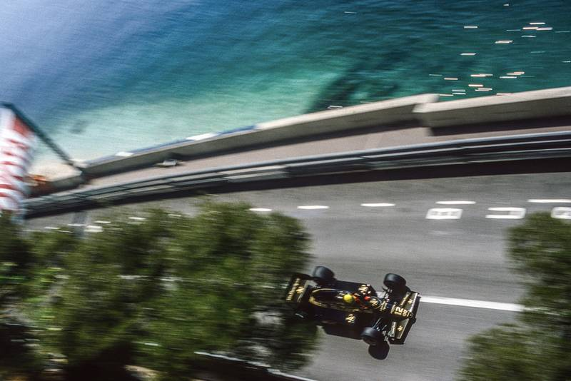 Ayrton Senna on the seafront in his Lotus during the 1985 Monaco Grand Prix