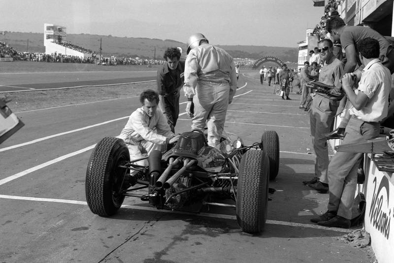 Jack Brabham gets out of his Brabham BT7 Climax.