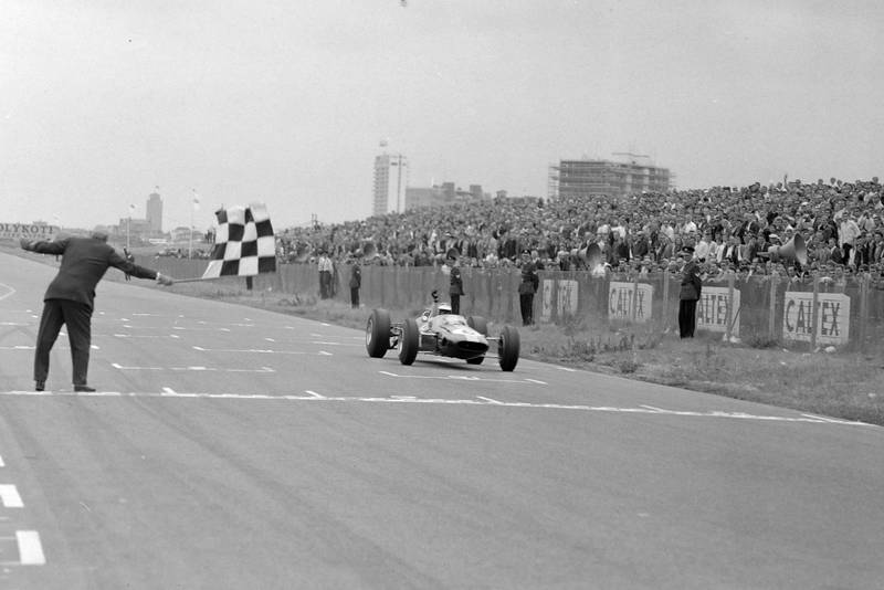 Jim Clark, Lotus 33 Climax, takes the chequered flag for victory.