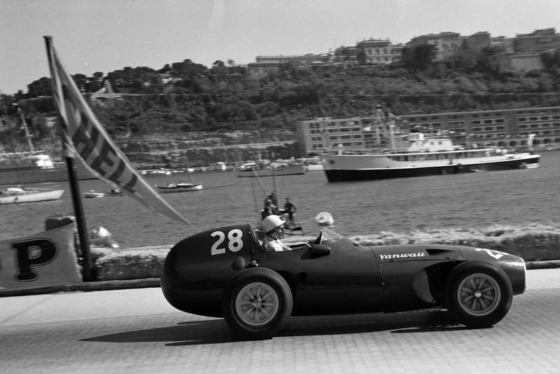 Stirling Moss races by the harbour in his Vanwall at the 1958 Monaco Grand Prix.