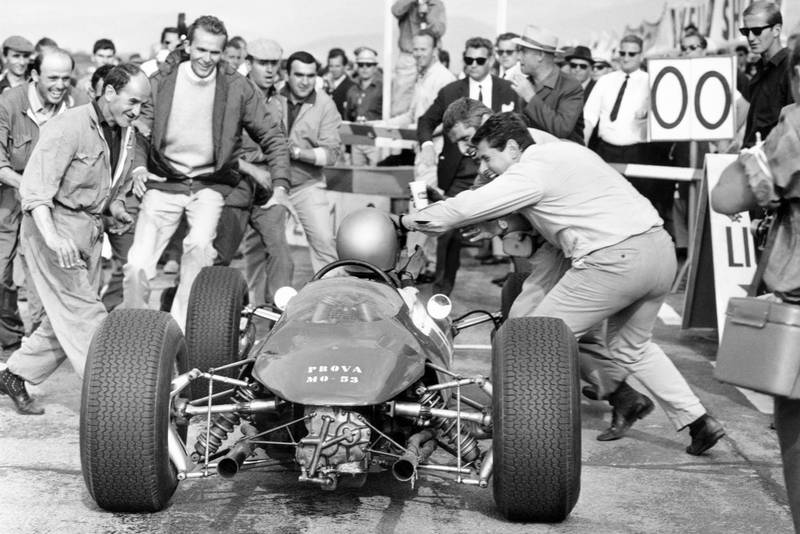 Lorenzo Bandini (Ferrari 156) enters the pits upon winning the race.