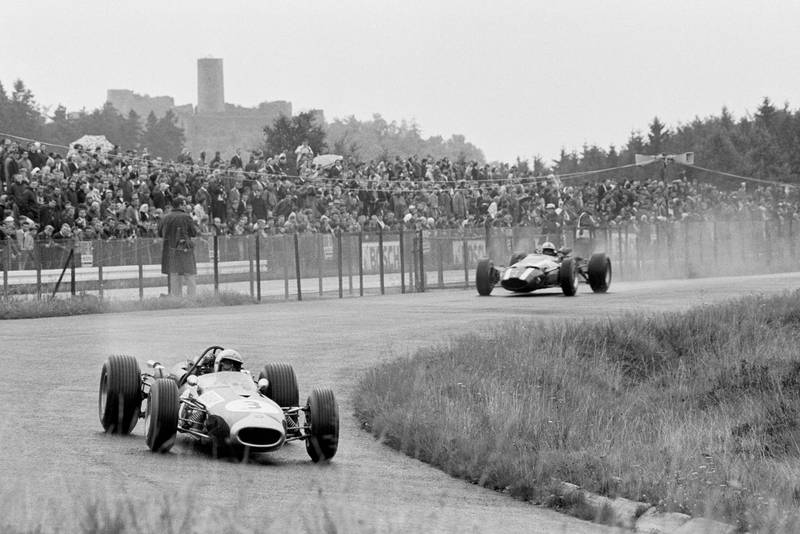 Jack Brabham (AUS) Brabham BT19 leads second placed John Surtees (GBR) Cooper T81 en route to his fourth successive Grand Prix victory.