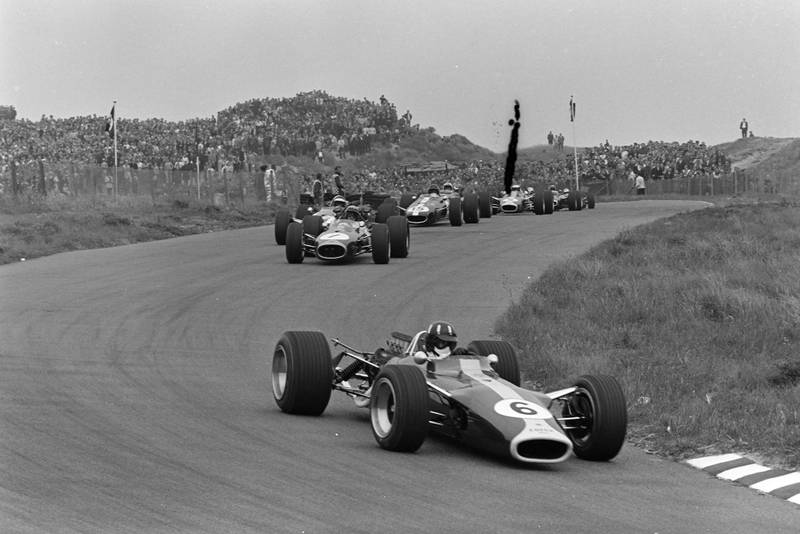 Graham Hill, Lotus 49 Ford leads Jack Brabham, Brabham BT19 Repco, on the opening lap.