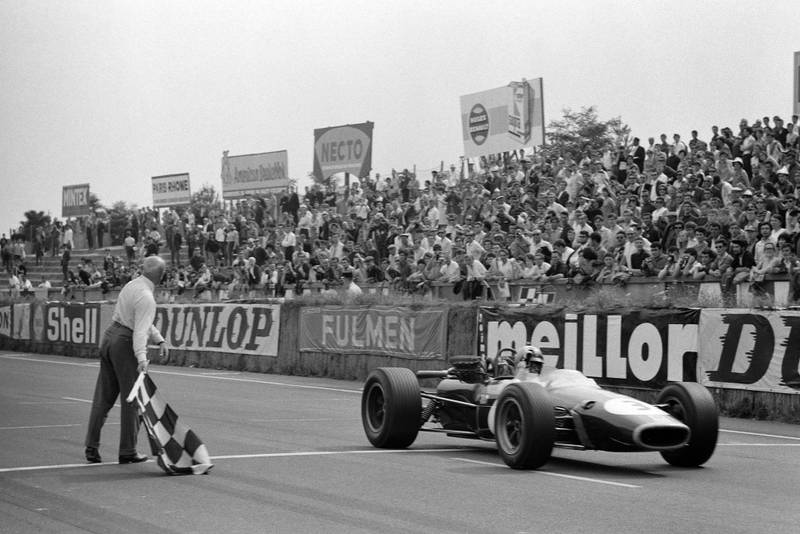 Jack Brabham, Brabham BT24 Repco takes the chequered flag for victory.
