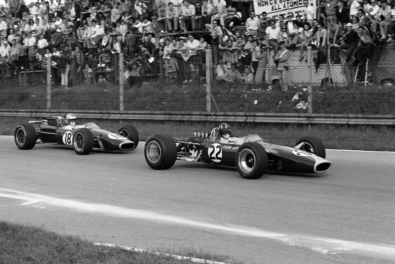 Graham Hill, Lotus 49 Ford, leads Denny Hulme, Brabham BT24 Repco.