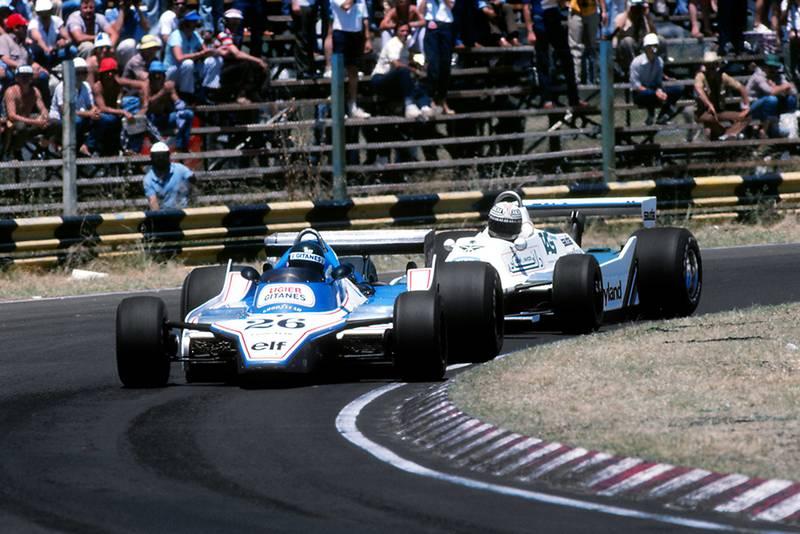 Jacques Laffite, in a Ligier JS11/15 ahead of eventual race winner Alan Jones driving a Williams FW07.