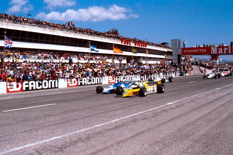 Rene Arnoux in a Renault RE20 leads Didier Pironi in his Ligier JS11/15 Ford and Carlos Reutemann in his Williams FW07B Ford at the start.