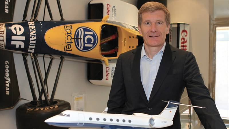 Thierry Boutsen in his Monaco office with his 1989 Canadian Grand Prix winning Williams-Renault on the wall