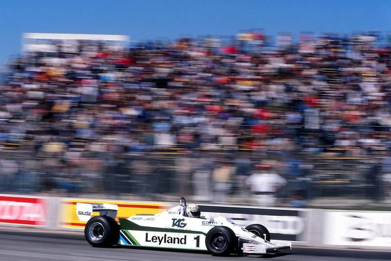 Race winner Alan Jones in a Williams FW07C.