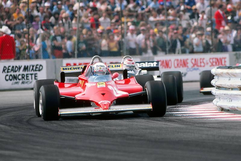 Didier Pironi (Ferrari 126CK) leads Nelson Piquet (Brabham BT49C) and Gilles Villeneuve (Ferrari 126CK).