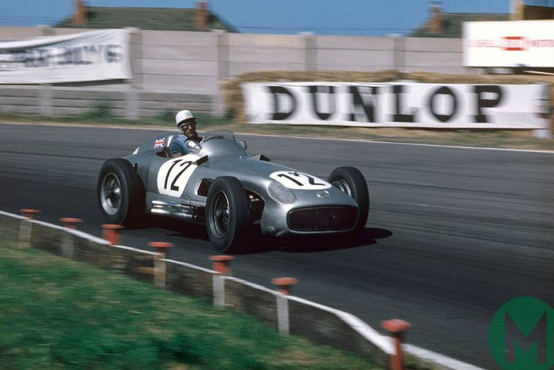 Stirling Moss leads at Aintree on the way to victory in the 1955 British Grand Prix