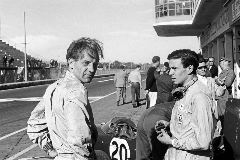Innes Ireland with Jim Clark in the pits at the 1961 Syracuse Grand Prix