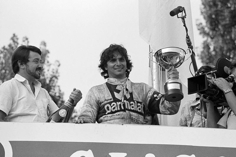 Race winner Nelson Piquet celebrates on the podium.